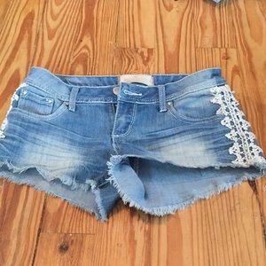 Jeans shorts with white lace sides